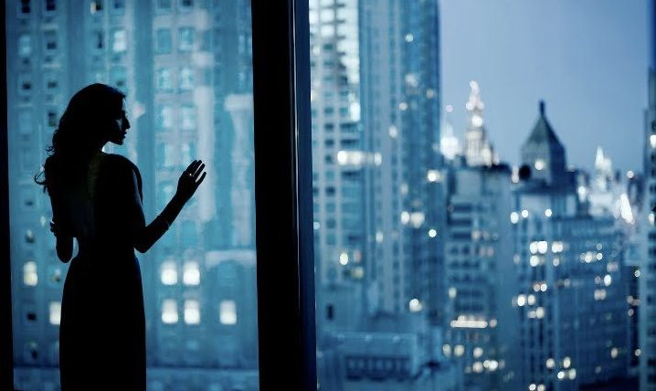 Woman looking at the city_1